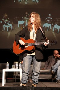 Patti Smith, with red guitar