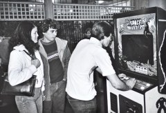 Young man playing Space Invaders